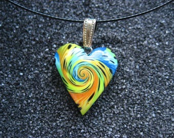 Small yellow/orange/blue spiral varnished polymer clay heart pendant