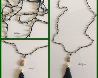 Long crochet necklace with dark green nappy, green crystals and turtle and drop stone