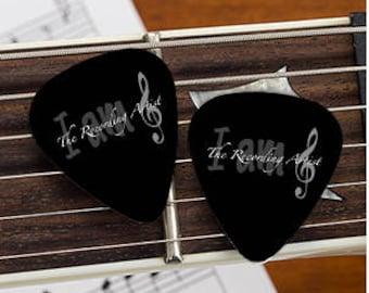 "10 ""I am The Recording Artist"" guitar picks."