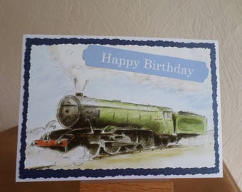 birthday card with green train in blue and white
