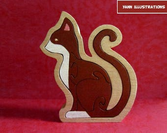 Cat sitting in fretwork wooden puzzle