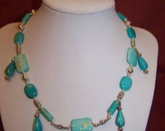Necklace turquoise beads with charm