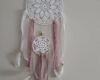 Dream catcher made of cotton, lace and feathers