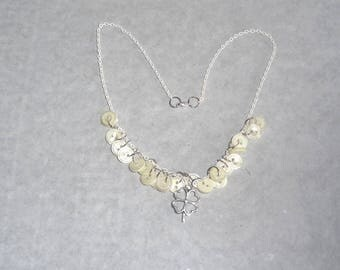 White buttons broken necklace