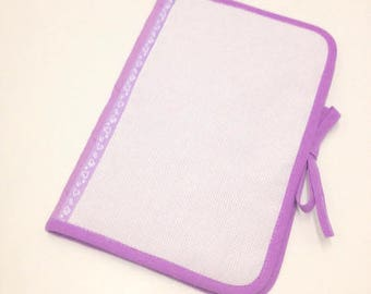 Health book has cross-stitch, purple fabric