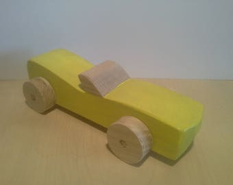 Wooden Toy: the yellow car made of beech wood