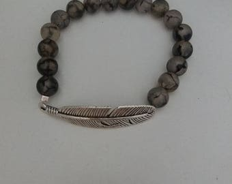Elastic bracelet with feather