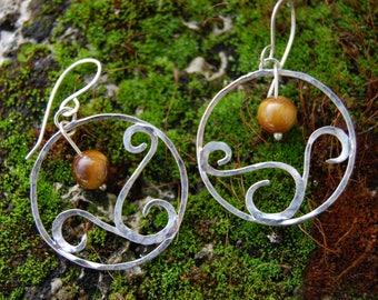 Jewelry earrings in sterling silver with Tiger eye bead
