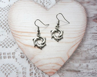 Pair of earrings jewelry dangling dolphins animal animals