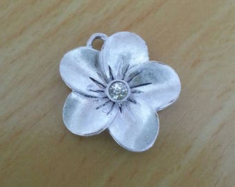 Silver flower. Flower shaped charm in silver. rhinestone heart. Sold individually