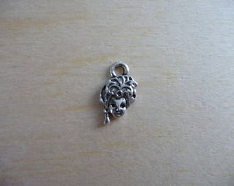set of 4 charms in the shape of silver colored Carnival mask