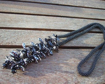Necklace black daggers and flowers