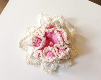 With beautiful crochet creation hair elastic.