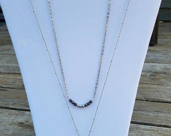 Druzy pendant layered with beaded bar necklace