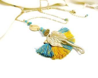 Boho-chic on solar yellow corolla of gold and turquoise elephant pendant necklace