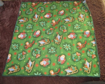 Green pattern fabric size 50 Christmas Holly sleds x 50cm
