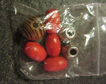 set of various red beads wood metal