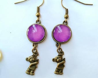 Nice pair of Earrings with 12 mm cabochon and his teddy