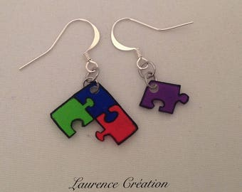 Earrings made of plastic crazy multicolored puzzle pieces.