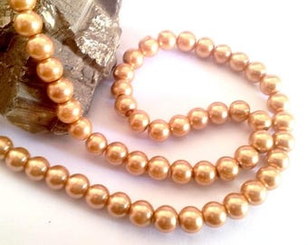 Wholesale lot of 100 Golden glass pearl beads, 8mm