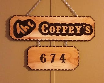 Custom carved sign with addresses