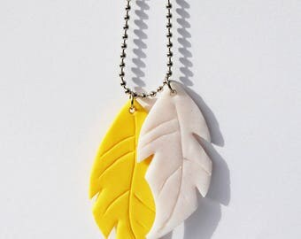 Yellow feather pendant and glittering white - polymer clay