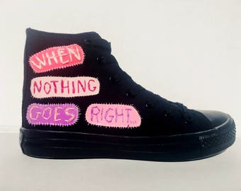 "Custom Converse High Top Sneakers Words of Encouragement ""When Nothing Goes Right, Go Left"" Hand Stitched Applique on Vinyl."