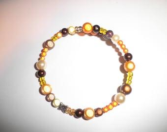 01021 - Memory wire bracelet single row tone orange / brown