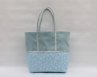 The bi-color sky blue cotton and printed Triangle Tote with a silver sequin trim