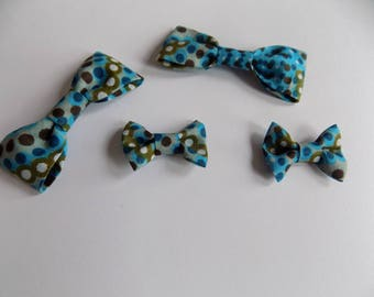 set of four blue/Brown/green fabric bows.