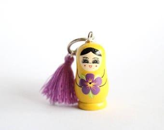 Keychain grigri MATRYOSHKA yellow and purple tassel