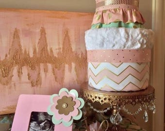 Diaper cake made with handmade plush blanket and burp cloth