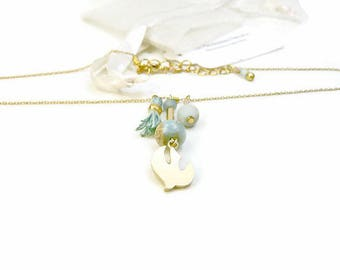 Gold plated minimalist pendant 16 K bird and pastel pale blue Jasper