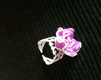 White filigree ring with purple flower