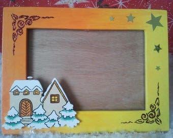 Orange yellow Christmas wooden 3D frame, landscape snow.