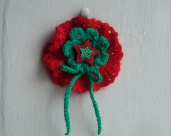 A Christmas decoration to hang handmade crochet - vintage red and green wool - little star