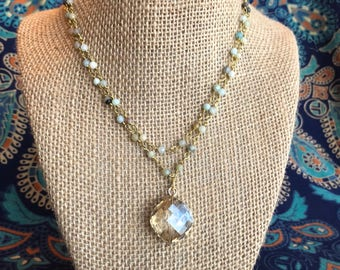 Double layered neutral beaded necklace with crystal