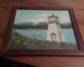 Painting of a Lighthouse in a Frame