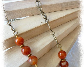 Necklace / long necklace made of metal and orange agate beads