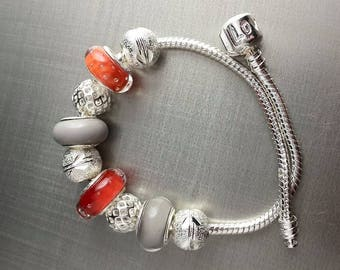 Bracelet made of glass in shades of Orange and gray. Lampwork Glass Beads