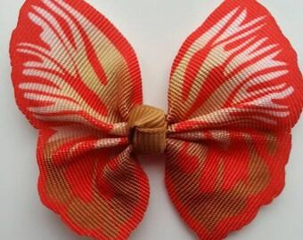 noeud en tissu imitation papillon 57*52mm dans les tons  orange et beige