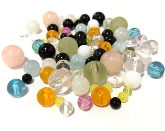 + or - 200 assorted glass beads