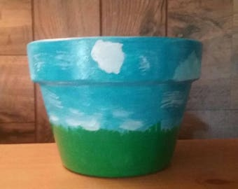 """Medium 4 1/2"""" (approx) Hand Painted Terra Cotta Pot with Green Grass and Pretty Blue Skies"""
