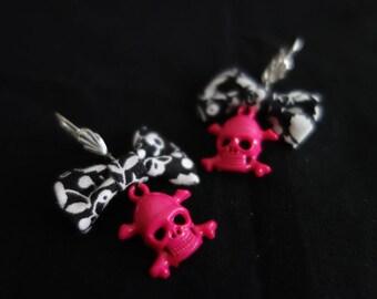 Bows pink skull charm earrings