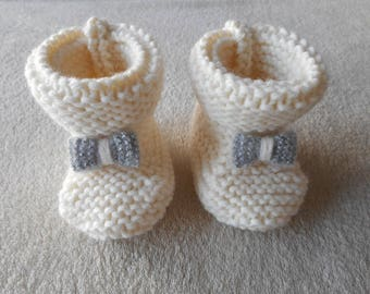 Ecru wool baby booties and Silver Bow