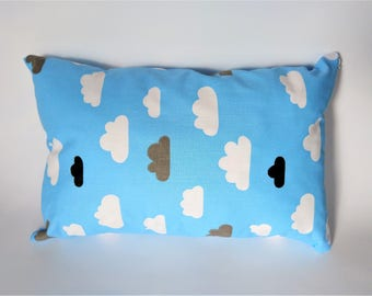 Small decorative pillow with clouds