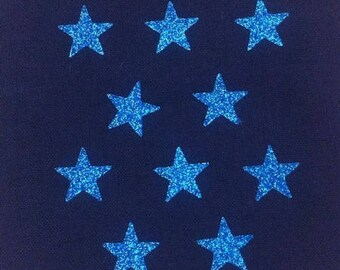 10 little stars clothing blue glittery 15x15mm