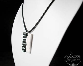 Polymer clay pendant, rectangle black and white, written in white
