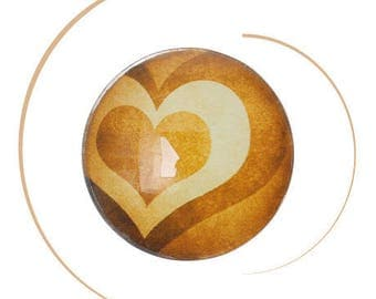 A heart, 20 mm diameter, thickness 5.2 mm round glass cabochon