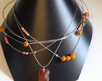 NECKLACE ORANGE BEADS AND TEDDY TISSUE